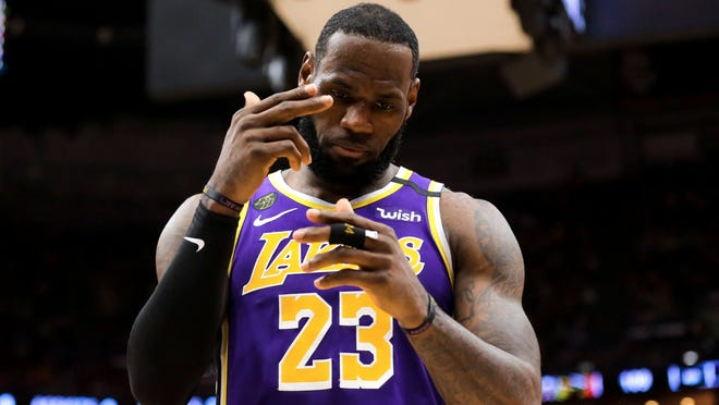 Los Angeles Lakers forward LeBron James reacts during the fourth quarter against the New Orleans Pelicans on March 1 at the Smoothie King Center. James is currently in his 17th season, his second with the Lakers.