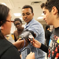 City High students learn how to check blood pressure during an event held by the City High Pre-Health Society on Tuesday, Dec. 1, 2015.
