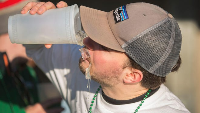 The annual Green Beer Day was in full swing in downtown Oxford Thursday, the day before the start of Miami University's Spring Break. The annual tradition started at Miami in 1952. The bars, like Brick Street, where this young man was drinking, opened at 5 am.