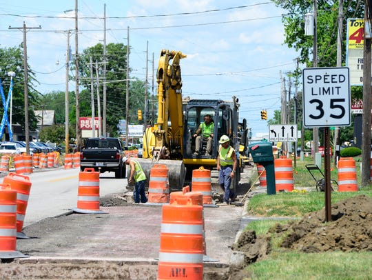 Construction workers repave U.S. 20 through the west