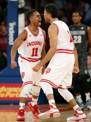 Indiana guards Yogi Ferrell (11) and James Blackmon Jr. (1) celebrate after Indiana went on a scoring run during the first half of an NCAA college basketball game against Georgetown at Madison Square Garden in New York, Saturday, Dec. 27, 2014.