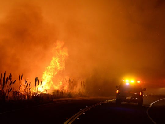Fire units work the Canyon Fire on the south base of Vandenberg Air Force Base Sunday night.