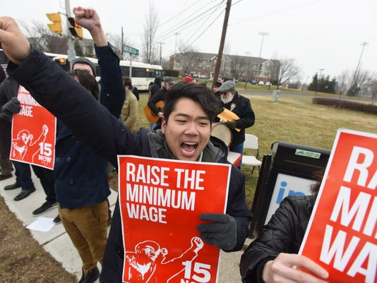Minimum wage activists stage a protest rally near Garden State Plaza mall