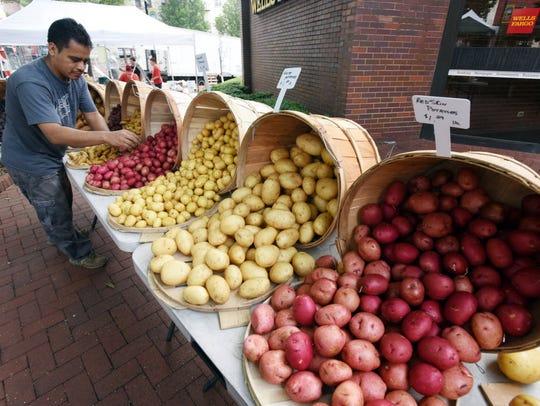 Federico Balbuena of Rutherford, NJ fixes up the potato