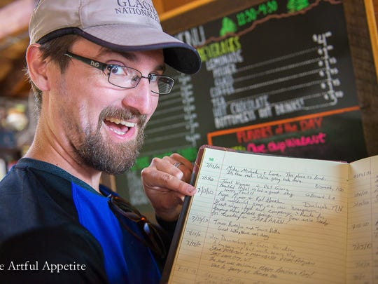 Karl Hoeschen finds the guestbook entry he and his wife Kate Minor wrote during their honeymoon at Sperry Chalet in 2010.