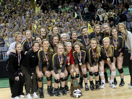 Ursuline Academy Lions pose for team photo  after winning