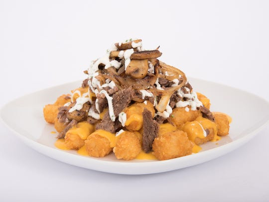 Steak and ale tots are among the new food items the