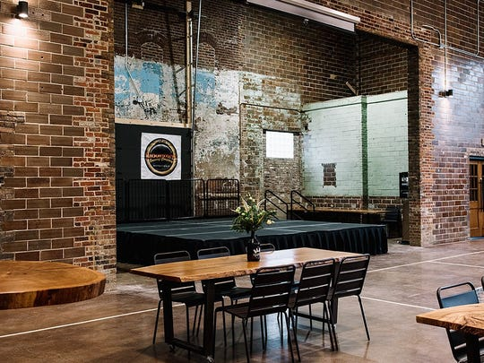 A seating area by a stage at Moontown Brewing Company in Whitestown.
