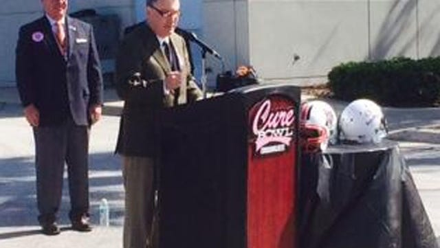 Commissioner Mike Aresco speaks at the announcement for the Cure Bowl.