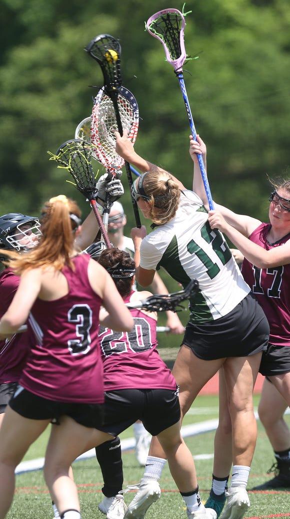 Brewster's Megan Beal (12) fires a shot for a first