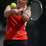 Richmond's Emma Lady returns the ball while playing No. 1 doubles in sectional tennis Friday at Richmond.