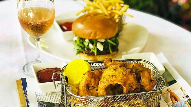 At Cafe Flora, fish and chips and a Tuscan burger now are featured at both lunch and dinner.