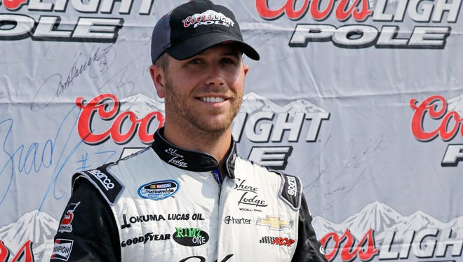 Driver Brian Scott poses after qualifying on pole for the NASCAR Nationwide Series auto race at Chicagoland Speedway in Joliet, Ill., Saturday, July 19, 2014.