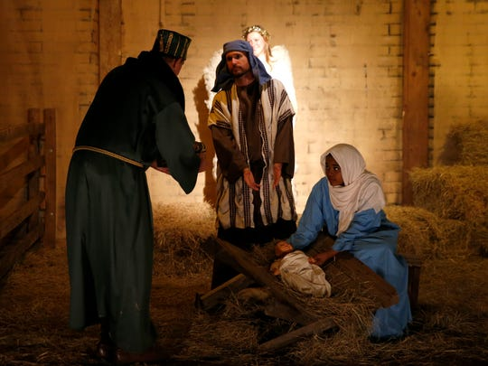 Church members portray Mary and Joseph in the manger
