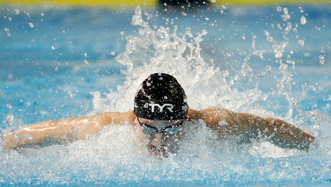 United States' Kelsi Worrell swims toward the gold medal in the women's 100m butterfly final at the Pan Am Games, Thursday, July 16, 2015, in Toronto. (AP Photo/Julio Cortez)