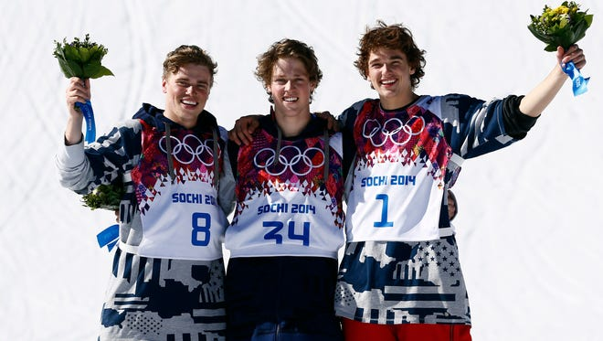 Afer sweeping the medals at the Sochi Olympics, champion Joss Christensen (center) poses with Gus Kenworthy (left) and Nicholas Goepper.