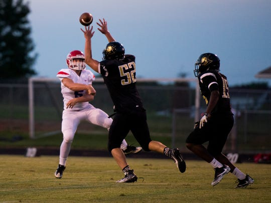 Jared Rankin, 52, attempts to block a throw by Jacob