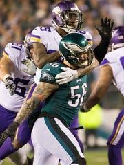 Defensive end Chris Long puts pressure on Viking quarterback