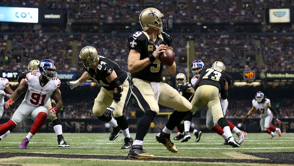 Saints quarterback Drew Brees  looks downfield during
