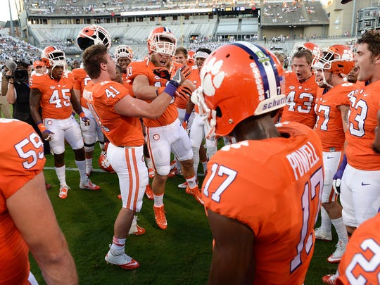 Clemson linebacker Ben Boulware (10) gets the Tigers fired up during pregame at Georgia Tech's Bobby Dodd Stadium in Atlanta last Thursday.