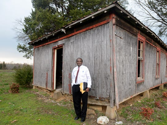 Hollis Skinner stands next to the Old Mt. Zion Negro