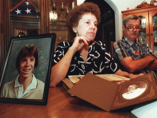 Shown in this file photo are Peggy and Charles Flynn Sr. with photos of their slain son, Chip. Both parents are now deceased.