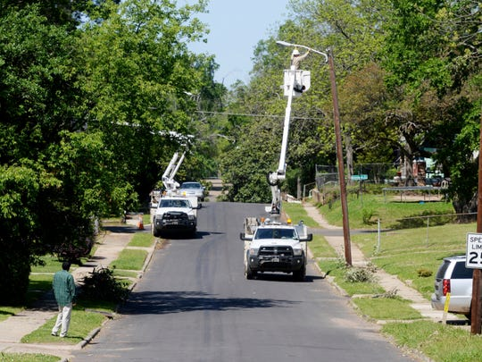 Swepco works to repair damage from the storm in the Queensborough neighborhood in Shreveport.