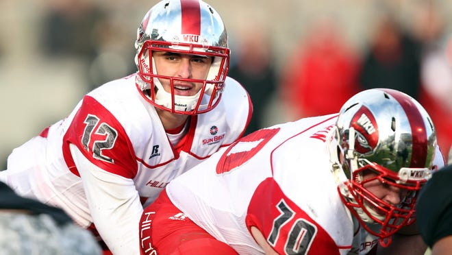 WKU quarterback Brandon Doughty calls out a play at the line during the second half of last season's game against Army.