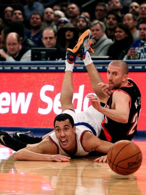 Knicks guard Pablo Prigioni passes the ball away from Trail Blazers guard Steve Blake during the first half at Madison Square Garden Sunday night.