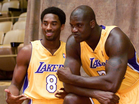 Kobe Bryant and Shaquille O'Neal pose for a photo.
