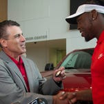 Fred M. Diaz, Division vice president and general manager, North America Trucks and Light Commercial Vehicles, Nissan North America presents keys to a new Nissan Titan truck to new Tennessee Titan and 2016 Heisman Trophy winner Derrick Henry.