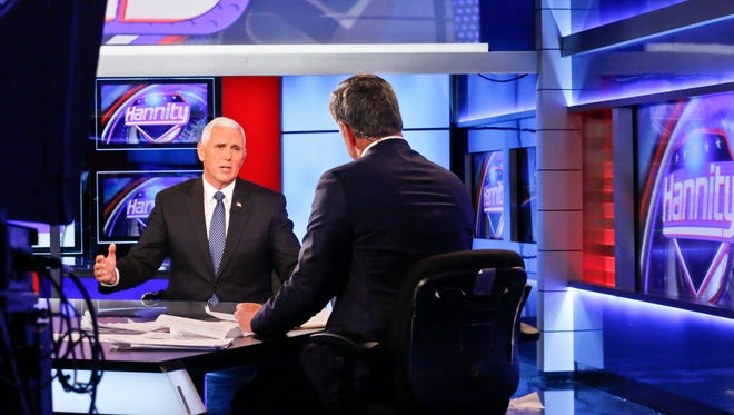 FOX News Channel's Sean Hannity, right, interviews Indiana Gov. Mike Pence after Donald Trump selected him for running mate on the Republican presidential ticket, Friday July 15, in New York.