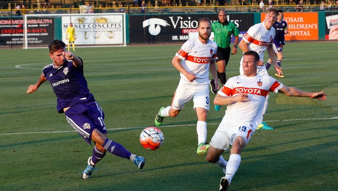 Louisville City's FC's Niall McCabe takes a shot on goal against FC Cincinnati.