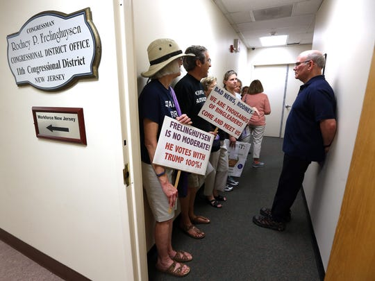 Newill Preziosi, l,  of Mendham, NJ waits in line with other members of the grassroots group 'NJ 11th for Change' inside a hallway of  the Morristown office of Congressman Rodney Frelinghuysen. The group  gathers for their weekly rally nicknamed 'Friday's with Frelinghuysen' as the GOP lawmaker is facing an ethics complaint after targeting a local liberal activist through a fundraising letter to her employer. May 19, 2017, Morristown, NJ.