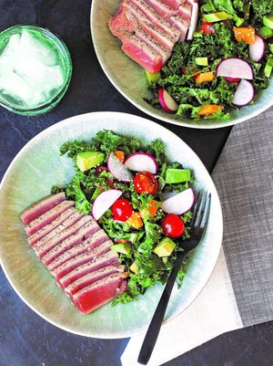 """Seared ahi tuna and mango stand out in this dish from """"Unbelievabowl"""" by Kelsey Preciado."""
