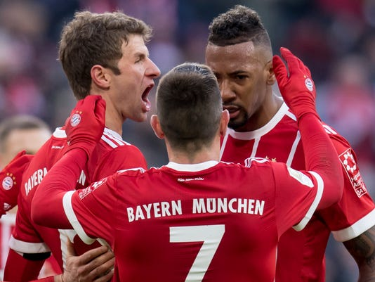 FILE - In this Jan.21, 2018 file photo, Munich's scorer Thomas Mueller, Franck Ribery and Jerome Boateng, from left celebrate after their side's first goal during the German first division Bundesliga soccer match between Bayern Munich and Werder Bremen in Munich, Germany.  Bayern Munich's dominance of the Bundesliga is hurting the league and likely to have a detrimental effect on the club itself. (Sven Hoppe/dpa via AP,file)