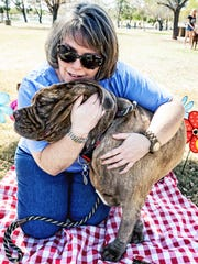 Cassie Langford hugs her dog, Penelope. She launched Louie and Friends Foundation to provide financial help for sick pets.
