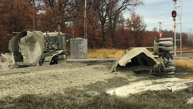 A semitrailer split in two large pieces after an Amtrak train collided with it Tuesday morning.