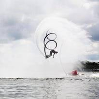 Flyboard inventor Franky Zapata hooks up a mic to be interviewed by French television.