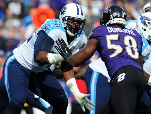 Titans offensive tackle Michael Oher (72) blocks  Ravens