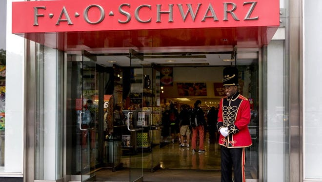 A doorman dressed as a toy soldier stands outside the FAO Schwarz flagship store on Fifth Avenue in New York, May 28, 2009.