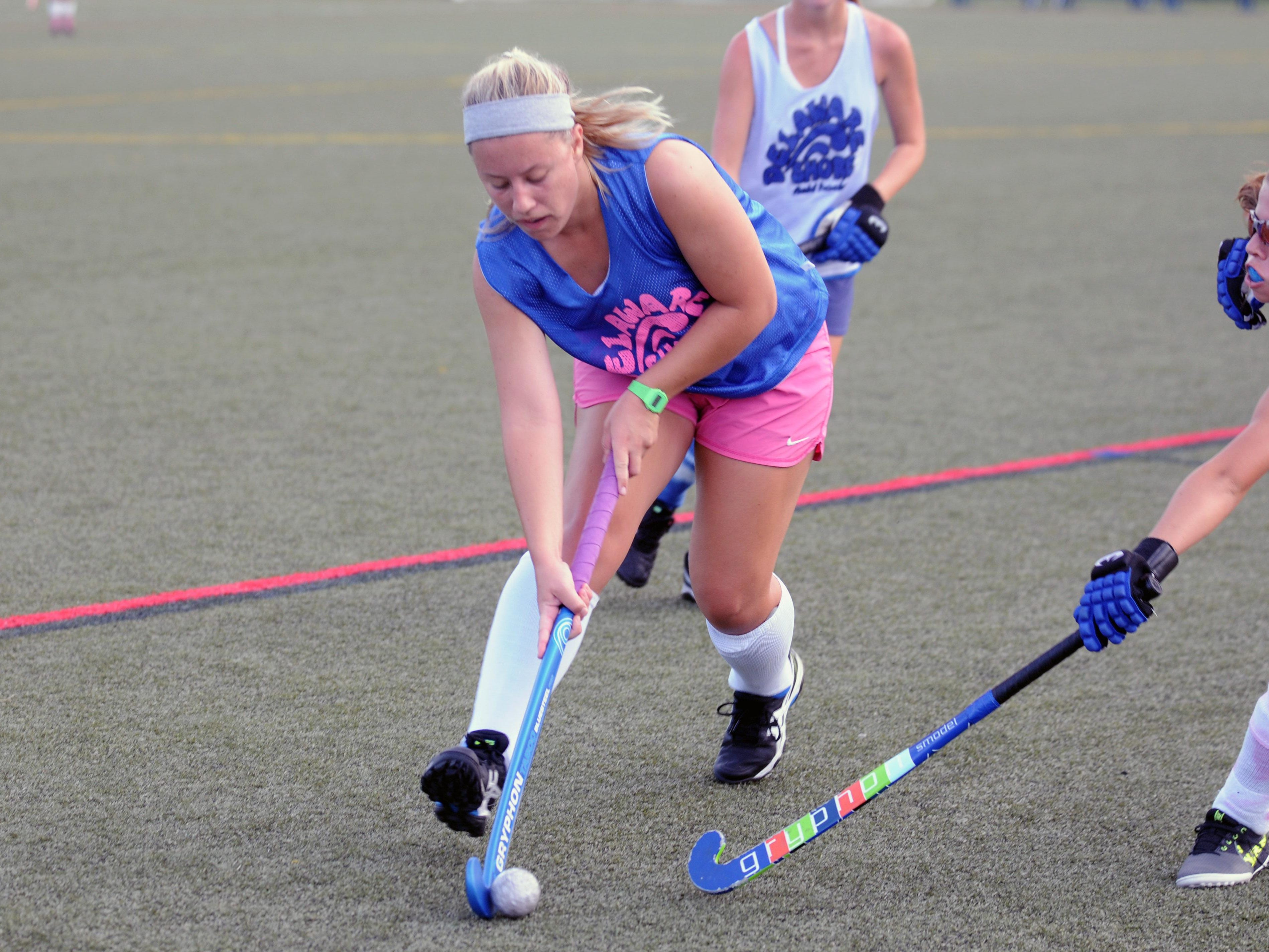 A Delaware Shore Field Hockey player works up the field during a summer league game at Cape Henlopen High School.