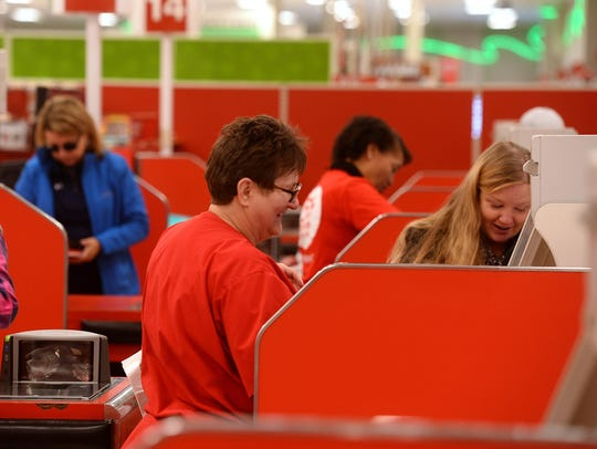 Target customers checkout on a Monday afternoon. Target
