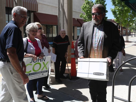 Congressman Doug LaMalfa, right, on Wednesday, May 2, 2018 delivers signatures opposing California's gas tax to the Shasta County Elections Office in downtown Redding.
