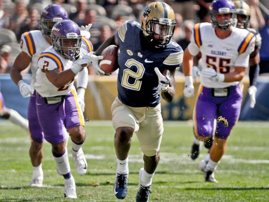 Pittsburgh's Maurice Ffrench, center, runs away from Albany's Tyler Carswell (2) and Ryan Lape (56) on his way to returning the opening kickoff for a touchdowns on Saturday. (AP Photo/Keith Srakocic)
