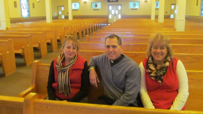 From left, Maria Tsohonis, Rev. Michael Galuppi and Becky Kruczkowski inside Our Lady of Good Counsel Church in Endicott, which is celebrating its 75th anniversary this year.