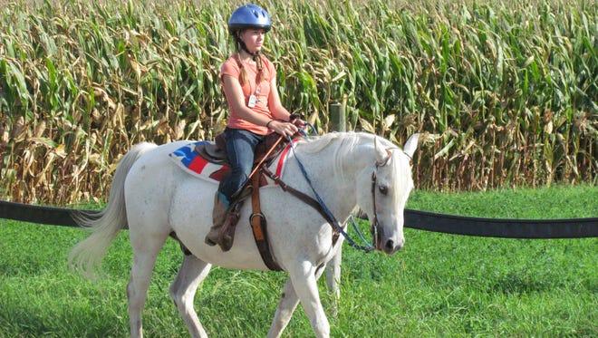 Emelia demonstrates an intermediate pattern while riding Leo.