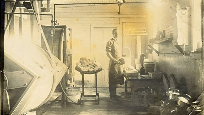 Making butter at the Cold Spring Creamery between 1903 and 1905. Man is possibly Odell Estes.