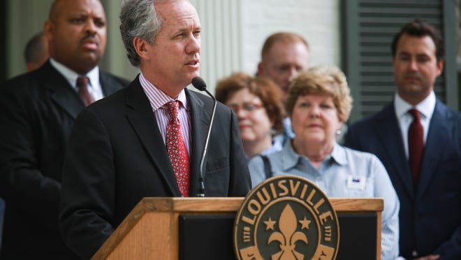 Louisville Mayor Greg Fischer addresses a large audience at the the historic Woodbourne House as he announces a plan to create new affordable housing units in a partnership with the Affordable Housing Trust Fund.