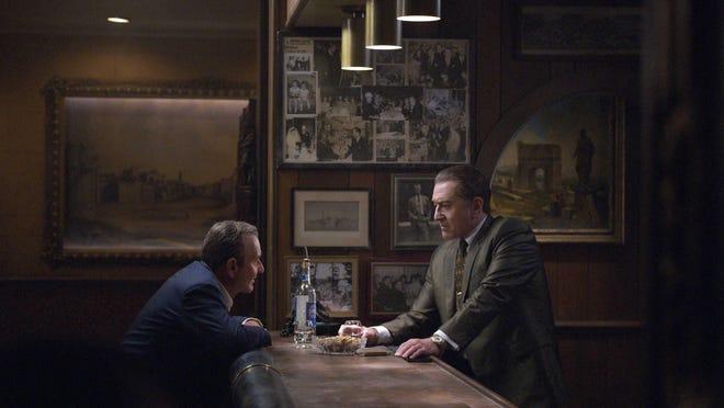 "Russell Bufalino (Joe Pesci, left) is a close confidante and boss to Frank Sheeran (Robert De Niro) in ""The Irishman."""